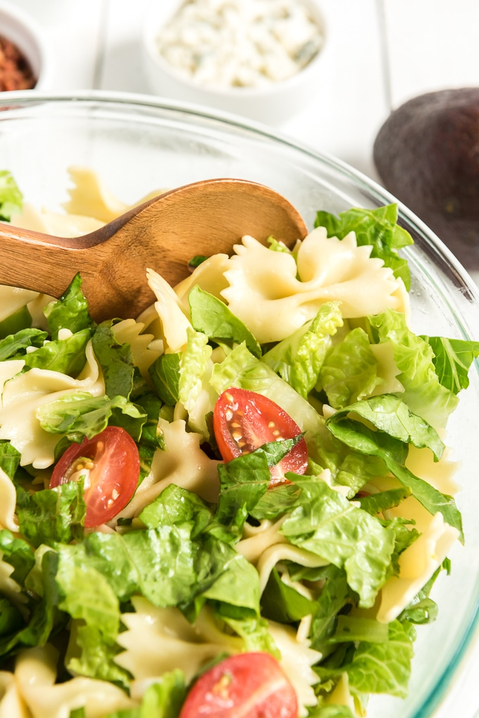 BLT pasta salad mixed with spoon