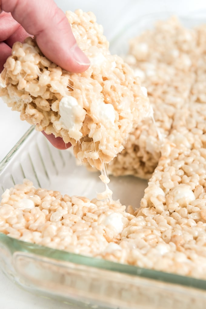 rice krispie treats being pulled from pan