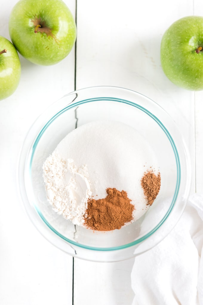 mixing apple topping in bowl