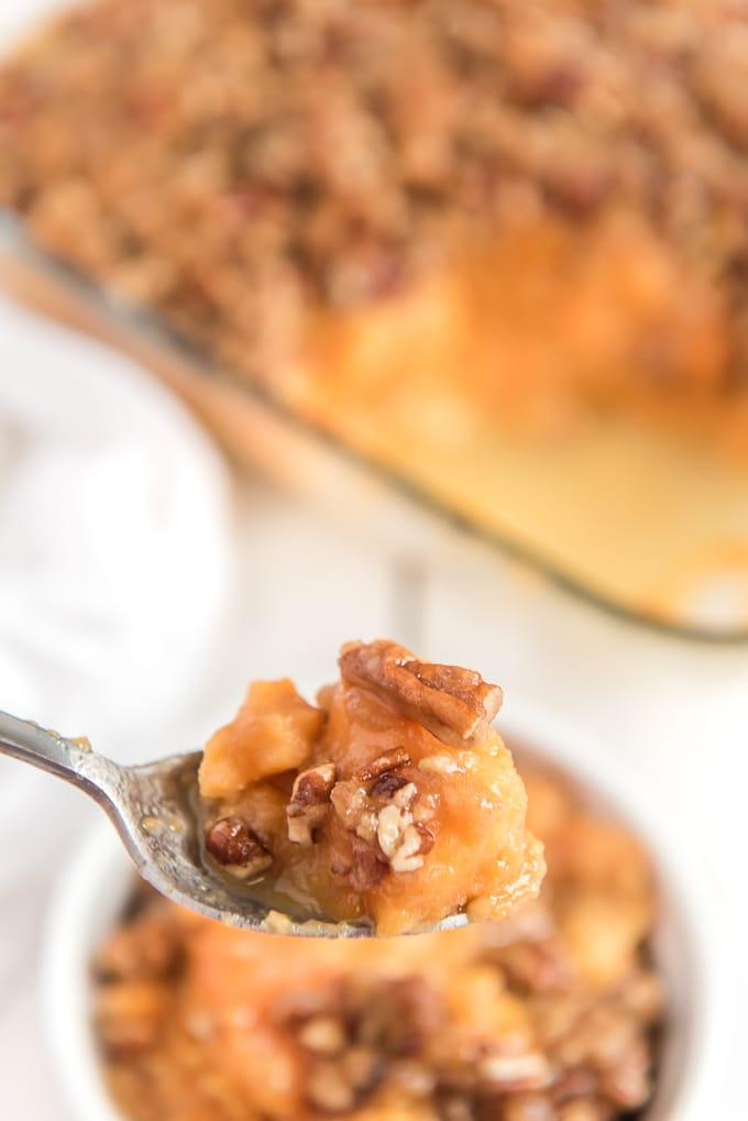 bite of sweet potato casserole on spoon