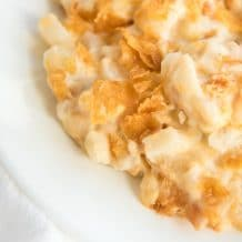 up close shot of cheesy hash brown casserole plated
