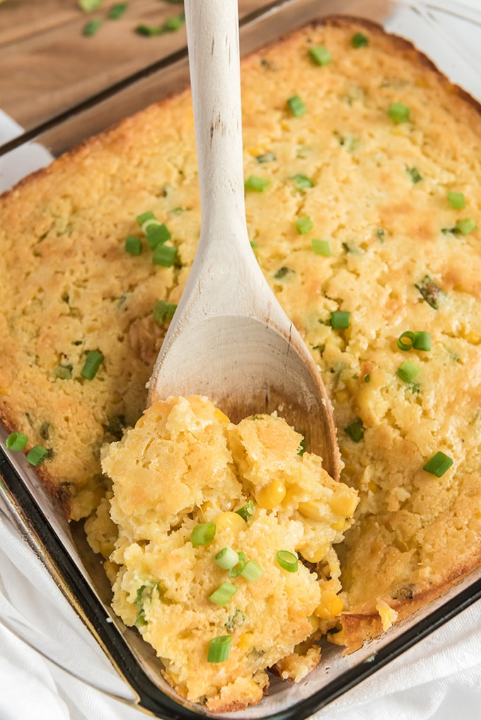 corn casserole recipe being spooned out of dish