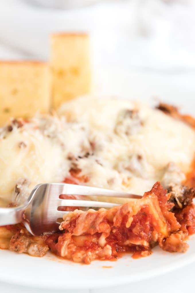 cut fork into baked ravioli