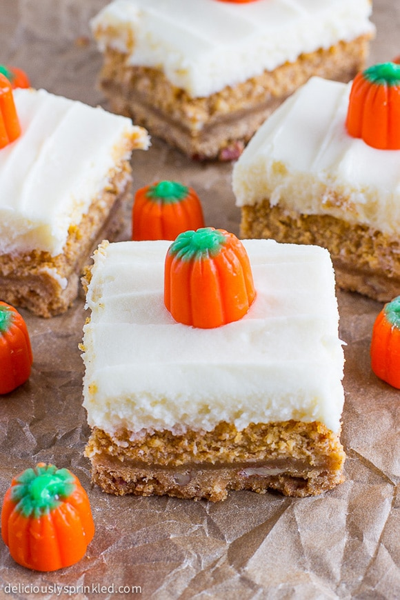 ready to serve pumpkin cheesecake bars on paper