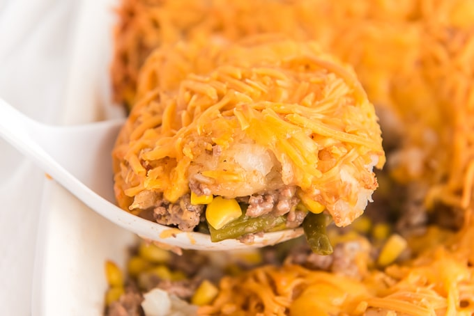 tater tot casserole on serving spoon