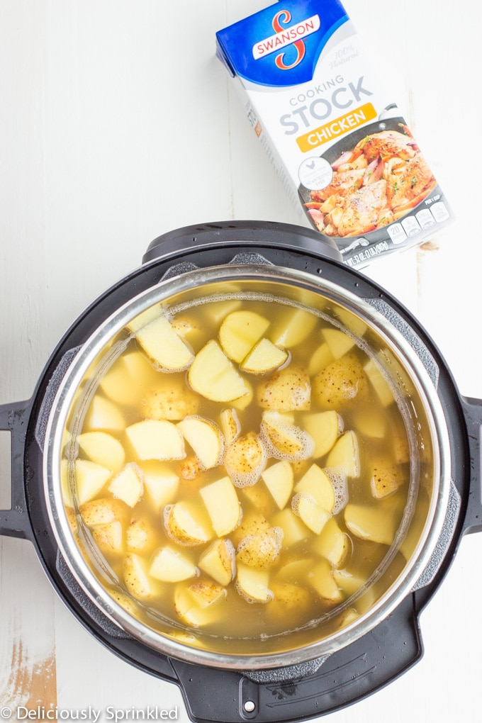 potatoes and chicken broth in an instant pot for mashed potatoes