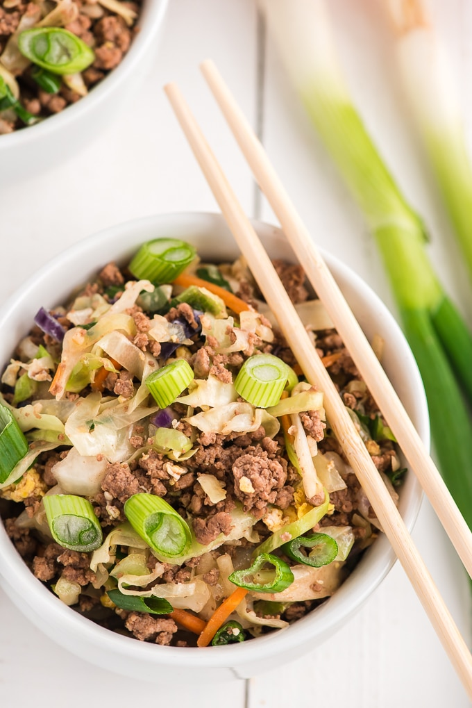 A serving of egg roll in a bowl is placed in a white bowl.