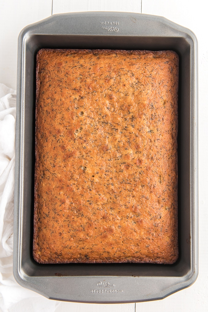 A baked banana cake is in the baking dish.
