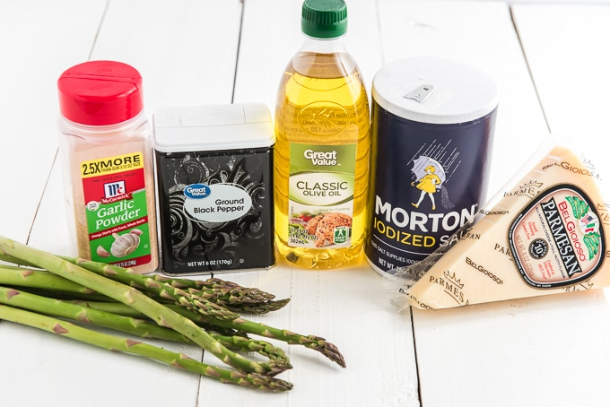 The ingredients for air fryer asparagus are on a white surface.