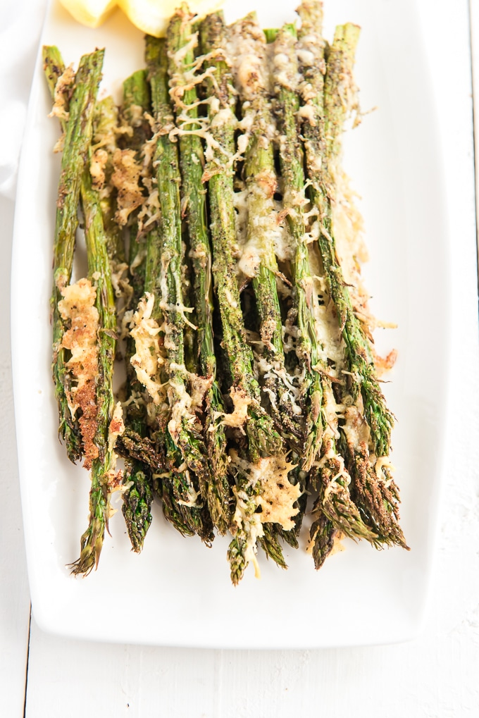 Cheese is crispy on top of air fried asparagus.