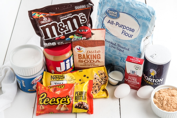 The ingredients for the cookies are placed on a white surface.