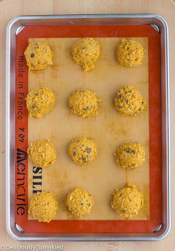 Dough balls are placed on a prepared baking sheet.